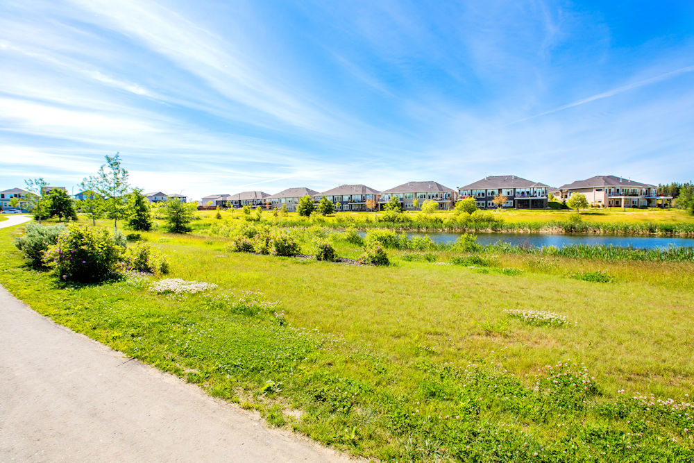 Community Photography and Streetscapes by Crystal Puim Photography in Edmonton Alberta Client Lamont Land Harvest Ridge Community Photos Spruce Grove Pond Feature