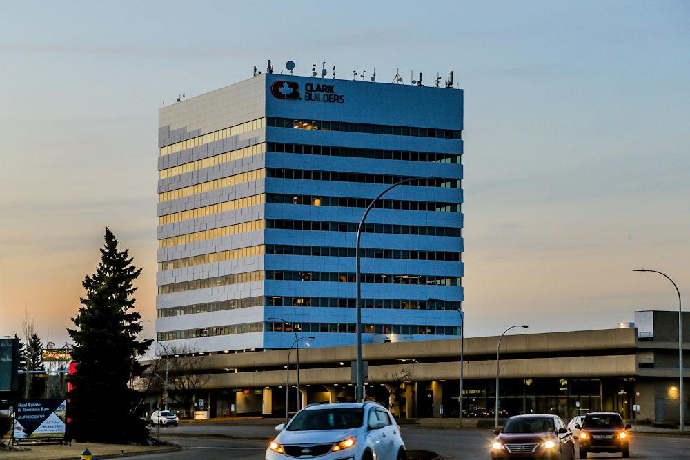 Exteriors and Cladding of ClarkBuilders Edmonton Office. Client Clark Builders. Photography by Crystal Puim Photography Edmonton Alberta Canada. Shot at dusk.